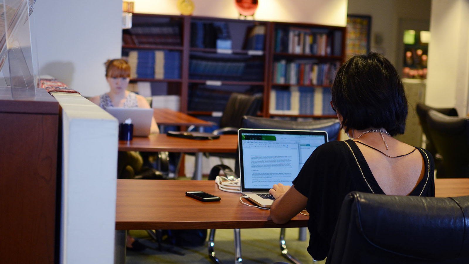 Research assistants work on computers at the Berkley Center