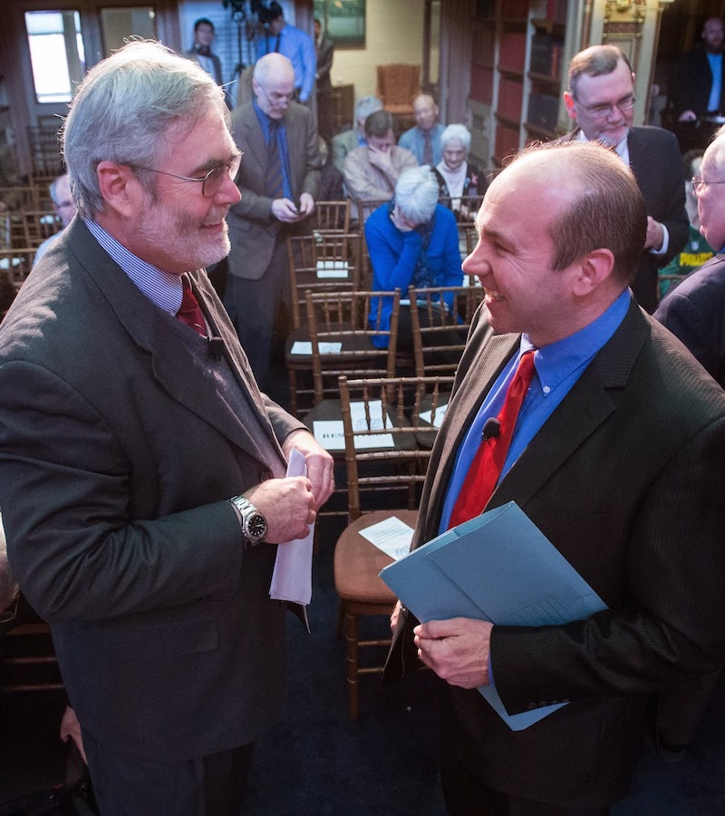 """Dennis Doyle and Gerard Mannion talk after the conference """"A New Vision for the Church"""" in March 2014."""