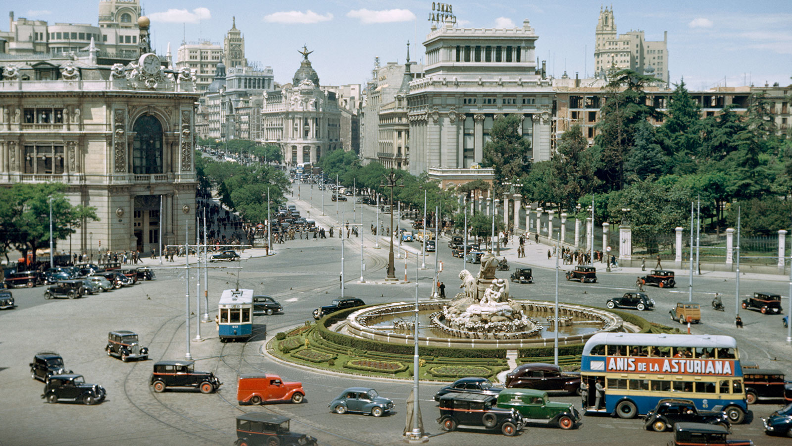 Traffic swirls around the Cybele's Fountain in central Madrid, 1950.